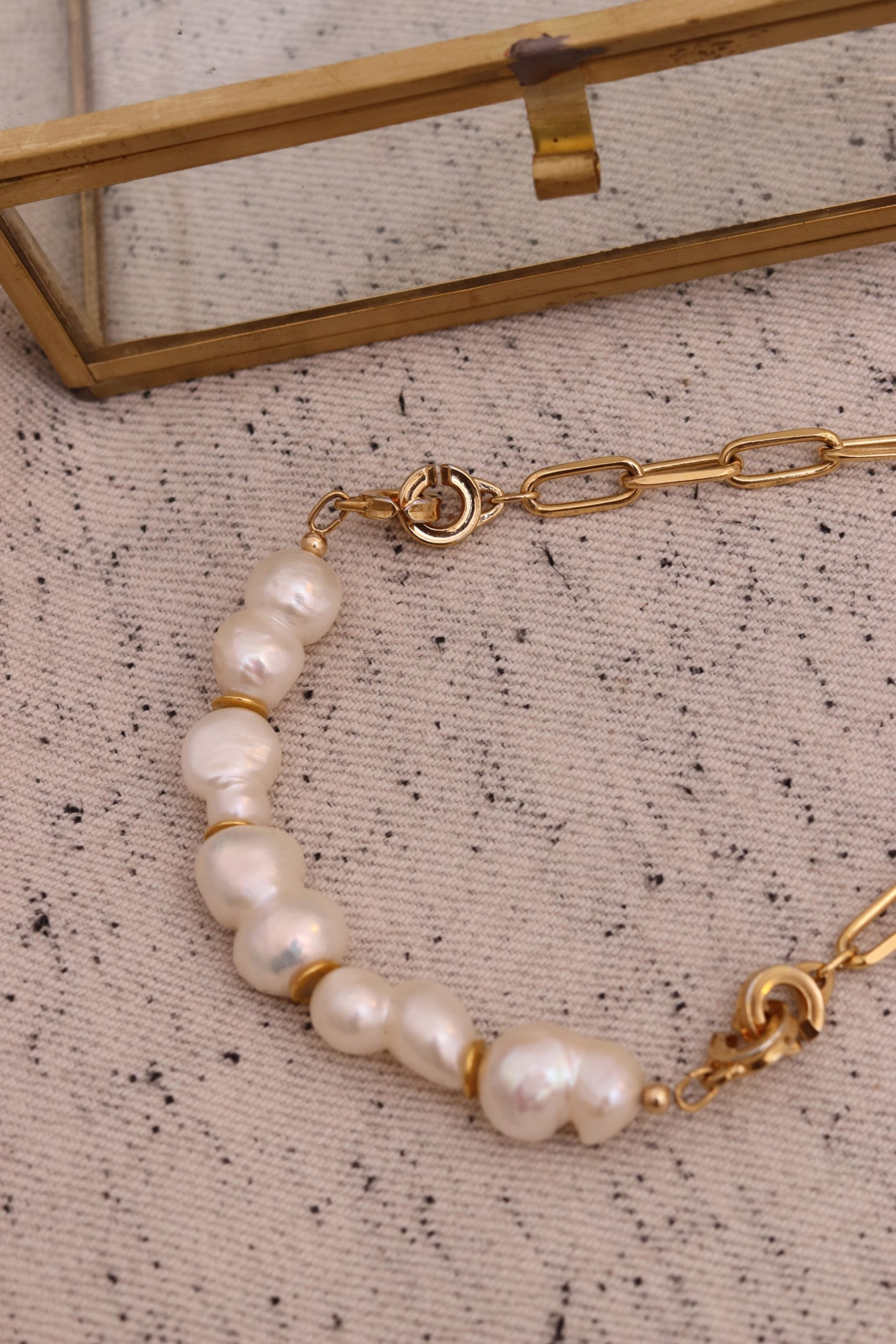 gold and white pearl necklace